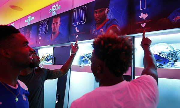Kansas football players check out the team's new locker room for the first time on Aug. 28, 2016. (Photo by Jeff Jacobsen/Kansas Athletics)