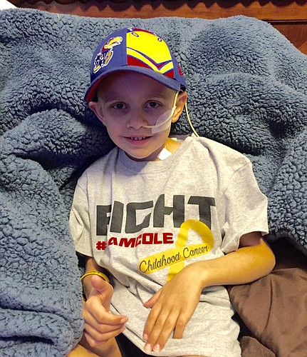 Seven-year-old Kansas football fan Cole Hayden sports one of his #TeamCole T-shirts as he continues his fight against undifferentiated sarcoma, a rare form of lung cancer.