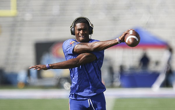 Kansas quarterback Montell Cozart (2) gets loose before throwing during warmups on Saturday, Sept. 3, 2016 at Memorial Stadium.