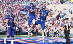 Kansas tight end Jace Sternberger (7) gets up to celebrate a touchdown by Kansas tight end Ben Johnson (84) during the first quarter on Saturday, Sept. 3, 2016 at Memorial Stadium.