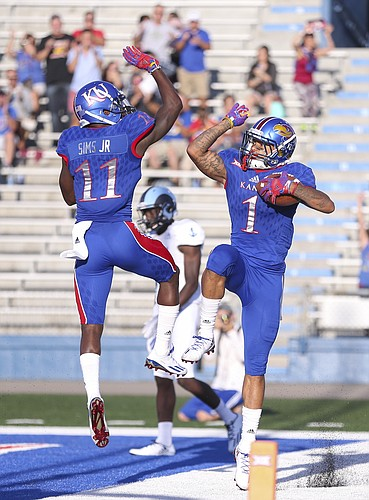 Kansas wide receiver Steven Sims Jr. (11) celebrates with Kansas wide receiver LaQuvionte Gonzalez (1) after Gonzalez's touchdown during the first quarter on Saturday, Sept. 3, 2016 at Memorial Stadium.
