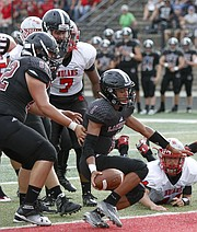 Lawrence High School quarterback Dante Jackson (1) crosses over the goal line for a touchdown in the 1st quarter of the Lions win against Shawnee Mission North Friday night at LHS.