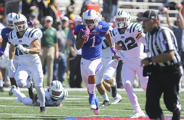 Kansas wide receiver LaQuvionte Gonzalez (1) runs back a kickoff for a touchdown during the second quarter on Saturday, Sept. 10, 2016 at Memorial Stadium.