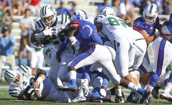Ohio running back Dorian Brown (28) trudges through the Kansas defense for a first down during the fourth quarter on Saturday, Sept. 10, 2016 at Memorial Stadium.
