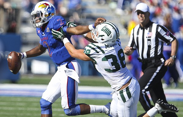 Kansas quarterback Montell Cozart (2) is run out of bounds by Ohio linebacker Chad Moore (38) late in the fourth quarter on Saturday, Sept. 10, 2016 at Memorial Stadium.
