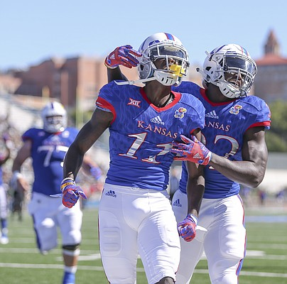 Kansas wide receiver Steven Sims Jr. (11) celebrates with teammate Ke'aun Kinner (22) after his second touchdown of the third quarter on Saturday, Sept. 10, 2016 at Memorial Stadium.