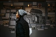 Haskell Indian Nations University freshman Cole Brings Plenty, Lakota, Cheyenne River Reservation, South Dakota, looks through the Haskell Memorial Stadium exhibit on Sept. 14, 2016 at the Haskell Cultural Center and Museum.