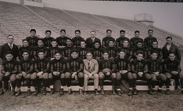 The 1926 Haskell Institute football team with head coach Frank McDonald, front and center.