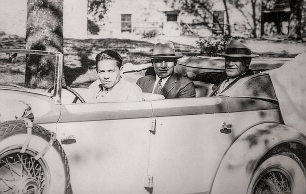 Legendary Haskell alumni Jim Thorpe, back right, and John Levi ride in the back of a car driven by 1932 olympic decathlete Buster Charles.