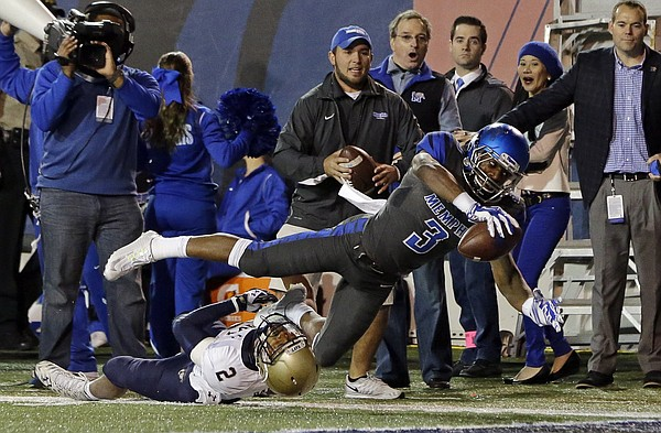 Memphis wide receiver Anthony Miller (3) gets past Navy safety Lorentez Barbour (2) to score a touchdown on an 11-yard pass reception in the first half of an NCAA college football game Saturday, Nov. 7, 2015, in Memphis, Tenn.
