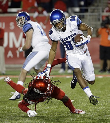Memphis' Phil Mayhue (89) avoids being tackled by Houston's Trevon Stewart, left, during the first quarter of an NCAA college football game Saturday, Nov. 14, 2015, in Houston.