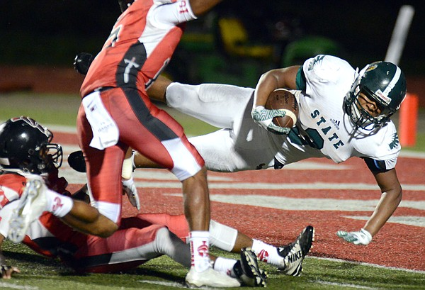 Zion Bowlin lunges into the end zone for a score in the first half Friday as Free State played Park Hill in Kansas City, Mo.