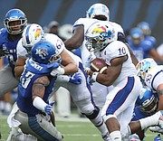 Kansas running back Khalil Herbert (10) gets around the Memphis line for a touchdown during the second quarter on Saturday, Sept. 17, 2016 at Liberty Bowl Memorial Stadium in Memphis, Tenn.