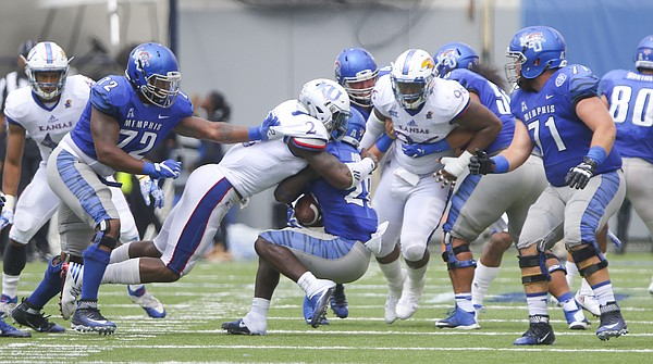 Kansas defensive end Dorance Armstrong Jr. (2) hits Memphis running back Doroland Dorceus (28) during the second quarter on Saturday, Sept. 17, 2016 at Liberty Bowl Memorial Stadium in Memphis, Tenn.