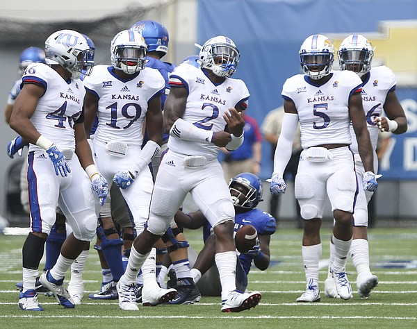 Kansas defensive end Dorance Armstrong Jr. (2) celebrates after a tackle for a loss during the second quarter on Saturday, Sept. 17, 2016 at Liberty Bowl Memorial Stadium in Memphis, Tenn.