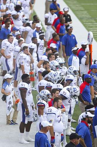 A deflated Kansas sideline watches late in the fourth quarter on Saturday, Sept. 17, 2016 at Liberty Bowl Memorial Stadium in Memphis, Tenn.
