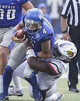 Kansas defensive tackle DeeIsaac Davis (99) sacks Memphis quarterback Riley Ferguson (4) during the third quarter on Saturday, Sept. 17, 2016 at Liberty Bowl Memorial Stadium in Memphis, Tenn.