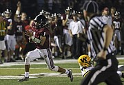 Lawrence High School quarterback Dante Jackson races past the last defender on a long run for a touchdown in the 3rd quarter of the Lions win against Shawnee Mission West Friday night at LHS.