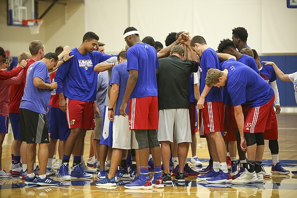 The Jayhawks come together at center court before the start of their fifth day of Boot Camp in the practice gym on Friday, Sept. 23, 2016 just after 6 a.m.