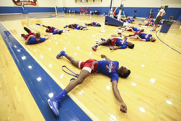 Kansas freshman Josh Jackson gets stretched out before the Jayhawks' fifth day of Boot Camp in the practice gym on Friday, Sept. 23, 2016 just after 6 a.m.