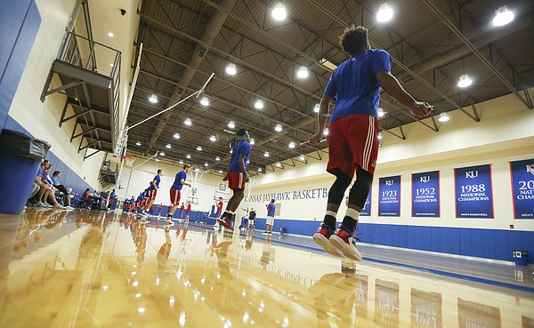 Kansas guard Devonte Graham, right, wields a jump rope with his teammates during Boot Camp in the practice gym on Friday, Sept. 23, 2016 just after 6 a.m.