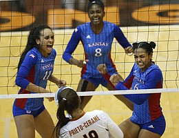 Kansas' Zoe Hill (6) celebrates scoring over Texas' Paulina Prieto Cerame (19) with Kelsie Payne (8) and Ainise Havili (11) during a match at Gregory Gym in Austin, Saturday, Sept. 24, 2016.