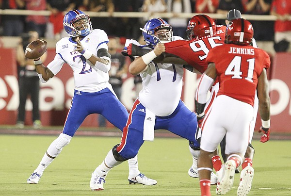 Kansas quarterback Montell Cozart (2) pulls back to throw during the first quarter on Thursday, Sept. 29, 2016 at Jones AT&T Stadium in Lubbock, Texas.