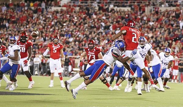 Kansas defensive end Dorance Armstrong Jr. (2) puts a hit on Texas Tech wide receiver Reginald Davis III (2) after Davis dropped a pass during the second quarter on Thursday, Sept. 29, 2016 at Jones AT&T Stadium in Lubbock, Texas.