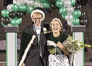 Will Benkelman and Kahler Wiebe walk off the field together after being named homecoming king and queen during halftime of Free State's football game against Olathe South on Friday evening at FSHS.
