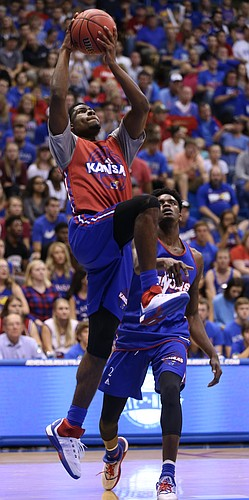 Kansas guard Malik Newman elevates to the bucket past LaGerald Vick during Late Night in the Phog on Saturday, Oct. 1, 2016 at Allen Fieldhouse.