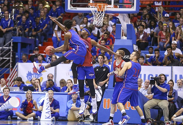 Kansas forward Carlton Bragg Jr. looks to defend against a shot from LaGerald Vick during Late Night in the Phog on Saturday, Oct. 1, 2016 at Allen Fieldhouse.
