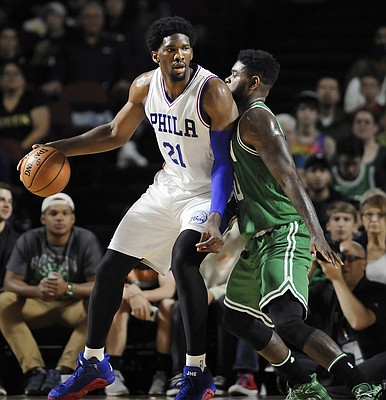 Boston Celtics' Amir Johnson, right, guards Philadelphia 76ers' Joel Embiid, left, during the first half of an NBA preseason basketball game, Tuesday, Oct. 4, 2016, in Amherst, Mass. (AP Photo/Jessica Hill)