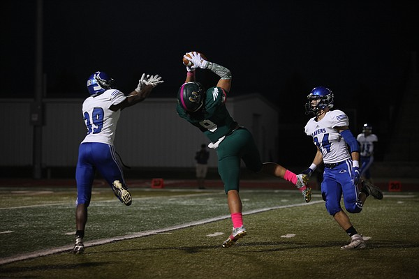 Free State's Noah Kema (8) receives a pass Friday night against the Olathe Northwest Ravens at FSHS. The Firebirds won, 35-0.