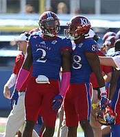 Kansas defensive end Dorance Armstrong Jr. (2) celebrates with Kansas wide receiver Jeremiah Booker (88) after Armstrong forced a fumble during the first quarter on Saturday, Oct. 8, 2016 at Memorial Stadium.
