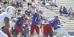 Kansas quarterback Ryan Willis (13) heaves a pass during the first quarter on Saturday, Oct. 8, 2016 at Memorial Stadium.