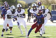Kansas wide receiver Steven Sims Jr. (11) tears down the field as he is trailed by the TCU defense after a catch during the first quarter on Saturday, Oct. 8, 2016 at Memorial Stadium.