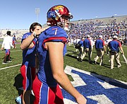 Kansas place kicker Matthew Wyman (7) gets a pat on the shoulder from teammate Gabriel Rui (39) after Wyman missed what could have been the game-winning field goal with seconds remaining in the game on Saturday, Oct. 8, 2016 at Memorial Stadium.