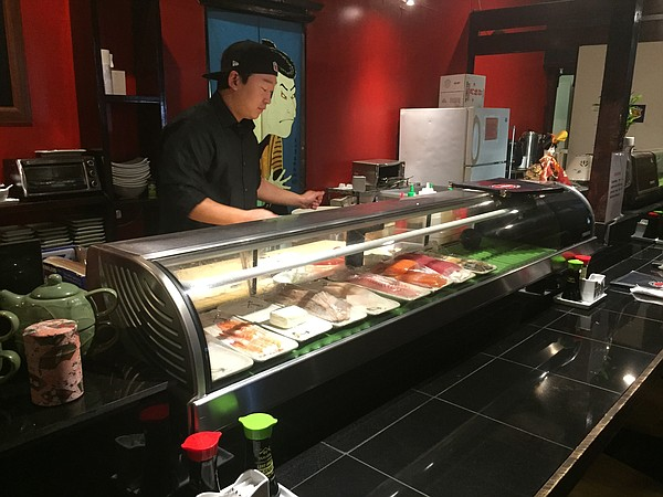 Chef Kevin Park prepares a dish at the sushi bar at Lawrence's Under the Sea restaurant at Sixth and Kasold.