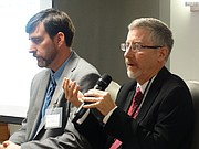 Chris Courtwright, right, an economist with the Kansas Legislature's Research Department, and Wichita State University researcher Jeremy Hill speak Thursday at the Kansas Economic Policy Conference at the University of Kansas, an annual event hosted by KU's Institute for Policy and Social Research.