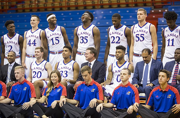 Kansas center Udoka Azubuike (35) gets his jitters out in the back row as he and the rest of the team, coaches and student managers prepare for a team portrait during Media Day on Thursday, Oct. 13, 2016 at Allen Fieldhouse.