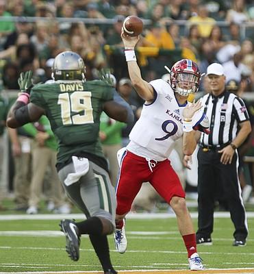 Kansas quarterback Carter Stanley (9) heaves a pass around Baylor linebacker Raaquan Davis (19) during the third quarter on Saturday, Oct. 15, 2016 at McLane Stadium in Waco, Texas.