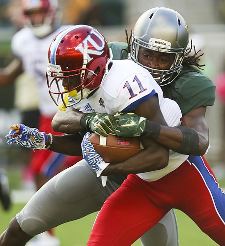 Kansas wide receiver Steven Sims Jr. (11) is brought down by Baylor safety Davion Hall (2) during the third quarter on Saturday, Oct. 15, 2016 at McLane Stadium in Waco, Texas.