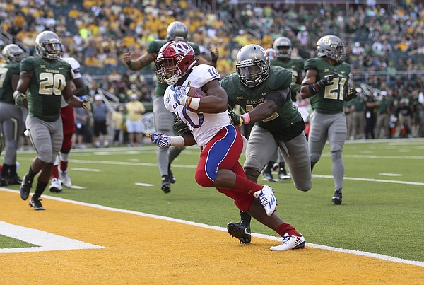 Kansas running back Khalil Herbert (10) squeezes into the end zone for the Jayhawks' only touchdown during the third quarter on Saturday, Oct. 15, 2016 at McLane Stadium in Waco, Texas.