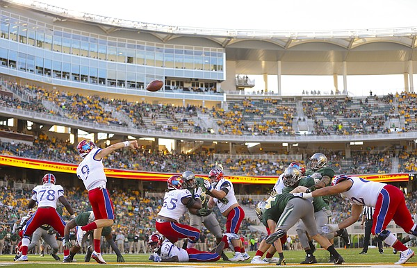 Kansas quarterback Carter Stanley (9) heaves a pass out of the end zone during the fourth quarter on Saturday, Oct. 15, 2016 at McLane Stadium in Waco, Texas.