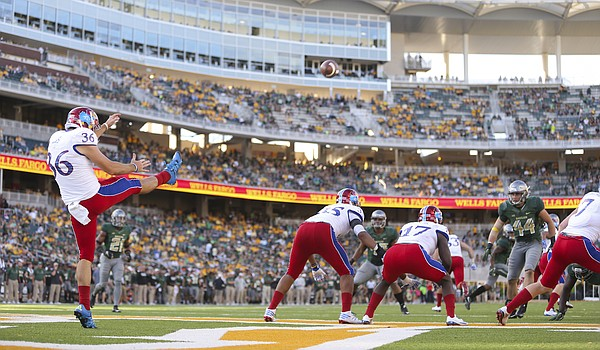 Kansas' Cole Moos (36) punts from the Jayhawks' end zone late in the fourth quarter on Saturday, Oct. 15, 2016 at McLane Stadium in Waco, Texas.