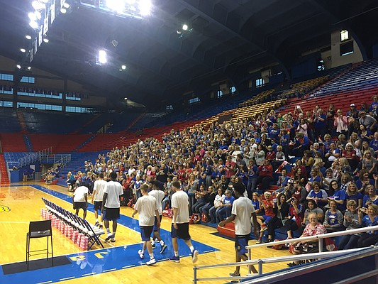 The Kansas men's basketball team heads to their seats for the Q&A portion of Wednesday's Ladies Night Out with Kansas basketball event at Allen Fieldhouse.
