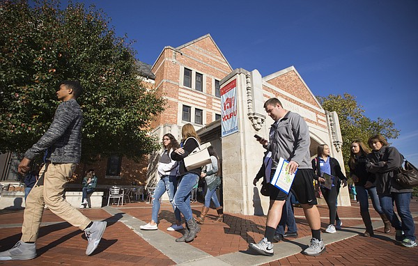 Prospective University of Kansas students walk past the Kansas Union while on a walking tour of the campus, Friday, Oct. 21, 2016. The Union is proposing a $45 million renovation and students will vote in the spring on whether to add a 30-year, $50 per semester fee to finance it.