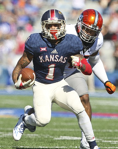 Kansas wide receiver LaQuvionte Gonzalez (1) takes off up the field past Oklahoma State linebacker Chad Whitener (45) during the third quarter on Saturday, Oct. 22, 2016 at Memorial Stadium.