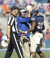 Kansas defensive coordinator Clint Bowen celebrates with linebacker Courtney Arnick after a defensive stop  during the third quarter on Saturday, Oct. 22, 2016 at Memorial Stadium.