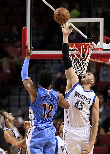Minnesota Timberwolves center Cole Aldrich (45) blocks a shot by Denver Nuggets forward Jarnell Stokes (12) during the second half of an NBA preseason basketball game in Lincoln, Neb., Wednesday, Oct. 12, 2016. The Minnesota Timberwolves won 105-88. (AP Photo/Nati Harnik)